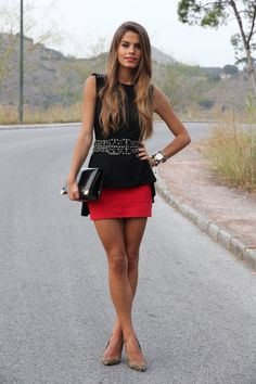 black peplum with oversized studded black belt over red skirt - gorgeous look
