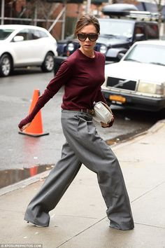 Serious stuff: Victoria looked sombre as she walked the NYC streets
