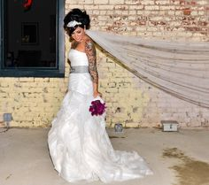 Tattooed bride (woot woot, love her tatts, that will be me... full sleeve rocking in white 10/14!