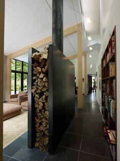 Firewood as a room divider. Netherlands. Jack Hoogeboom: Villa Renesse II