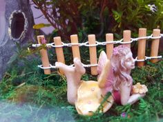 Fairy Lily with enchanted tree stump from our range of gorgeous fairies terrificterrariumsandfairygardens.co.nz