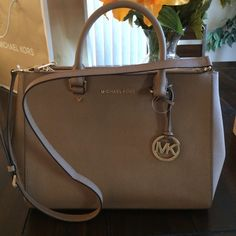 MICHAEL KORS! MAKE ME AN OFFER!!!!! Large satchel Authentic Michael Kors! Dark Khaki in color. genuine leather . Comes with dust bag, but the dust bag has a few marks from rubbing in my closet, just had to mention, it's not a big deal. Brand new never been used. Too big for me. My loss your gain! Comes with tag for proof of authenticity! Michael Kors Bags Satchels