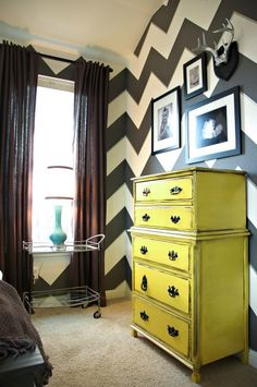 chevron walls and yellow dresser…love it! a smaller chevron print would be perfect for a wall or two in our room- same color scheme and all! Doing our room n yellow and navy blue @ Home Design Ideas Paredes Chevron, Style At Home, Yellow Dresser, Colored Dresser, Chevron Dresser, The Design Files, Home And Deco, My New Room, My Dream Home