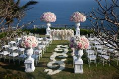 Love the big antique flower urns! not crazy about the floral runner..like the white with the petals at the edge