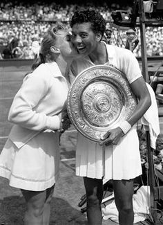 Althea Gibson, being congratulated on Wimbledon win, she won in 1957 and 1958, the first African American to do so.