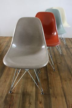 Original fibreglass DSW side chairs designed by Charles Eames and made by Herman Miller in the late 50s/early 60s.  Love the colours, which are greige, terracotta, seafoam green and parchment.