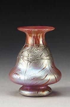❤ - Loetz | Iridescent art glass vase with heavy sterling overlay.