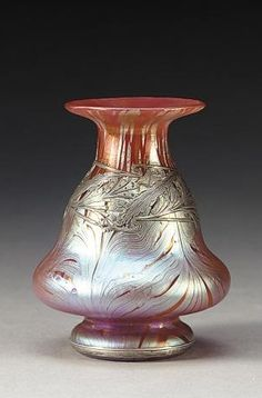 ❤ - Loetz |  Iridescent art glass vase with heavy sterling overlay.