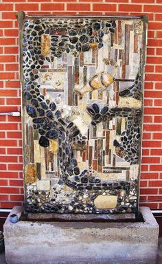 """It's Summer 2014 and Mike Squared Mosaics is creating cool and tranquil water features. Stone, tile, and real fossils make up this custom made fountain. Polished river rock along with Trylobytes, Fish, and Snail Fossils were integrated into this weeping wall.  Water streams down the face of the wall over and in between the protruding rock formations into a 13"""" deep pool which creates a tranquil and serene setting. Call Mike at 303-657-0261 for more information."""