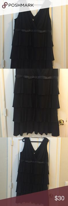 Beautiful black tiered dress - Size 22 Purchased at Macy's a few years ago. Size 22 but could fit a 20 with a large bust and probably 24 too. So flattering! Material is perfect to hang well, not clingy, & the tiers hide everything! Wore for a formal event but could be dressed down a little. Top of shoulders have cinching, feminine but not too thin for self conscious ladies. The dress has been smashed in my closet for awhile because I love it and didn't want to let it go so it could benefit…