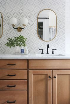 Modern Farmhouse Bathroom Renovation: Gorgeous wooden vanity with carrara marble countertop and mid century style knobs and pulls from Schoolhouse electric. This bathroom also features a blue herringbone tile floor and marble mosaic tile backsplash. Bad Inspiration, Bathroom Inspiration, Bathroom Ideas, Bathroom Organization, Master Bathroom Wallpaper Ideas, Ikea Bathroom Vanity, Wooden Bathroom Vanity, Hall Bathroom, Bathroom Trends