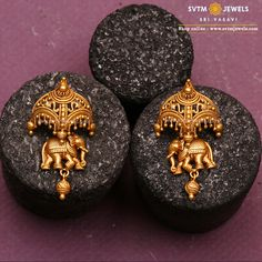 Ariana Elephant Earrings Shine bright, step out in style with this lovely gold earring.This yellow gold Earrings Studded with parade Elephant Umberalla. Gold Jhumka Earrings, Gold Mangalsutra, Jewelry Design Earrings, Gold Earrings Designs, Gold Jewellery Design, Antique Earrings, Antique Jewellery, Gold Earrings For Women, Stone Earrings