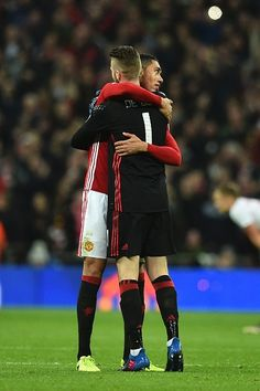 Manchester United's Spanish goalkeeper David de Gea and Manchester United's English defender Chris Smalling embrace on the final whistle in the...