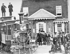 The American Civil War: November 18, 1863: Lincoln travels to Gettysburg.  This photograph captured President Lincoln at Hanover, Pennsylvania on his way to deliver a few remarks at the dedication of a national cemetery in Gettysburg, Pennsylvania.In this zoomed image, you can see Lincoln standing to the right of the locomotive--the tall man in the distinctive top hat.