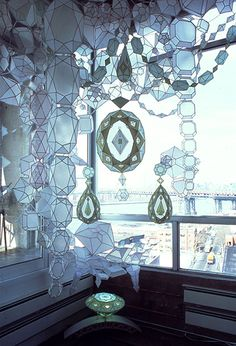 Massive, glowing webs of geometric gems climb the walls, successfully controlling the behavior of early afternoon light. It's only upon close inspection that the pieces reveal themselves to be painstakingly handcrafted, light as a feather paper sculptures {by Brooklyn~based artist Kirsten Hassenfeld}.