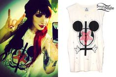 """We know how much Ash Costello loves both Mickey Mouse and the clothing brand UNIF. She instagrammed a picture wearing UNIF's """"Disneylamb"""" Muscle Tee ($56.00) with a pentagram and inverted cross."""