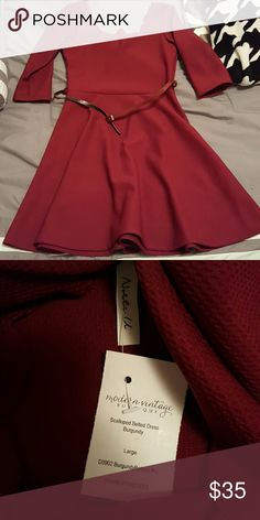 Burgundy scalloped dress with belt Nwt. Never worn. Fits a little snug. Has a scalloped neckline. Will try to get a better pic. Dresses Midi