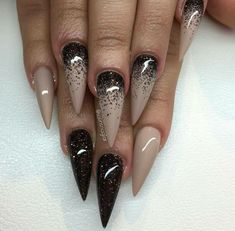 Nude stiletto nails with brown accent nails and glitter