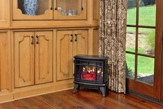 The Duraflame 8511 Black Infrared Electric Fireplace Stove - pays homage to the classic designs of traditional wood stoves. Modern Electric Fireplace, Electric Fireplace Insert, Fireplace Heater, Fireplace Inserts, Fireplace Ideas, Electricity Consumption, Classic Fireplace, Stove Heater, Electric Stove