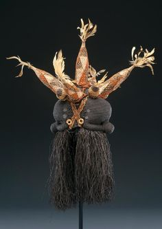 Africa | Janus mask (Idangani Society) from the Sala Mpasu culture of DR Congo | Fiber, raffia, pigment, and feathers | 20th century