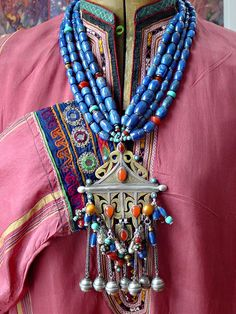 by Helena Nelson-Reed   Vintage Turkomen pendant is combined with chunk lapis lazuli (from Afghanistan) barrel beads and carnelian, Tibetan silver and amethyst, Tibetan silver and fresh water pearls, amber - resin, vintage glass, contemporary glass and turquoise.   SOLD