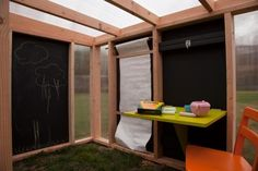 Outdoor playhouse with chalkboard walls and an art station. Fun and keeps the chalk mess off of carpet!