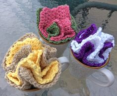 """What a great idea for a Spring holiday gift!  Two handmade crocheted 7"""" x 7"""" solid color dishcloths folded together and set into a mug."""