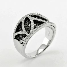 Black and white diamond ring. 1.19ctw of black diamonds with .45 ctw of round white diamonds set in 18k white gold. Pink Diamond designs. LQ12465L. Available at Murphey the Jeweler.