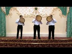 """Doira, and """"Uzbek Traditional Music"""". Percussion trio and dancers perform."""