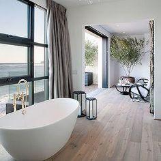 The Stone House Malibu - bathrooms - gray toned hardwood floors, hardwood bathroom floors