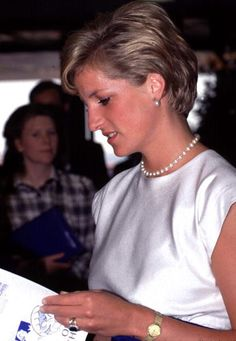Princess Diana reads during a conference for deaf people, August 9, 1990.
