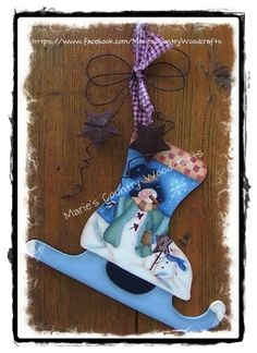 Wooden snowman skate painted by Marie's Country Woodcrafts using a design by Karen Wisner.