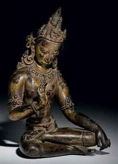 A gilt bronze figure of Bodhisattva, Nepal, Kathmandu Valley, 14th century. Seated in paryankasana, with one foot resting on the opposite thigh, his right hand in abhayamudra. 7¾ in. (19.7 cm.)