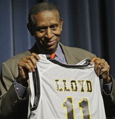 Former NBA player and coach Earl Lloyd displays the Marquette Hilltopper jersey he was given following his talk Monday, February 2, 2009 at Marquette University High School in Milwaukee, Wis. Lloyd was the first African-American to play in the NBA. His appearance was part of Black History Month.  MARK HOFFMAN/MHOFFMAN@JOURNALSENTINEL.COM