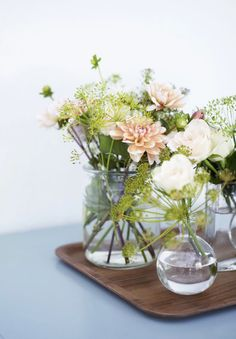 Amazing summer bouquets with different sorts of flowers in pastel colors.