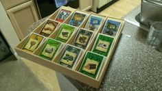 Settlers of Catan + Expansion Card Holder.   This would be cool integrated into a box for the game.