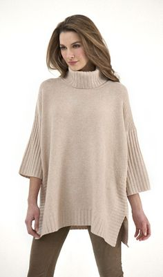 Kinross Cashmere...cozy couture.  The armholes make it the best poncho ever!