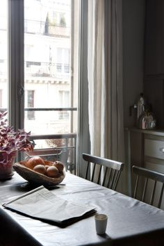 paul raeside, photographer, interiors photographer, daylight, paris apartment, wooden table, balcony , dark shadows