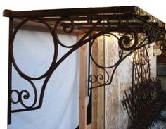 """Antique Iron Awning - Bracket Dimensions 31"""" high by 35"""" deep.  Overall…"""