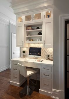 Cute idea for the Pulte Planning Center. Cute wallpaper on the walls and white marble counter tops and shelves above!!