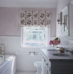 """I know this isn't the """"look"""" you're going for, but I do love this subway tile, 1/2 way up the wall around the entire bathroom!"""