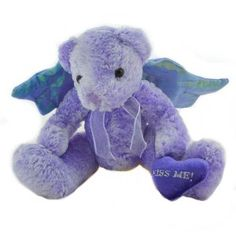 Adorable Purple Bear with angel wings. The wings have wire along the top to shape. She is holding a heart that says 'Kiss Me'. The fur is some of the softest I have ever felt!    6 1/4 inch tall, sitting wing measure 10 inches and have shapable plastice wire stiffiners. THe polyethelene pellets allow this angel to sit beautifully.