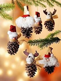pinecones, spraypainted lightly with gold, sprinkled on the top with glitter, and add a gold deer figure or tree or gifts