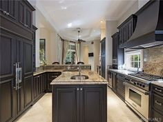 Proof that a kitchen doesn't have to be vast and immense to be gorgeous | Estuary at Grey Oaks | Naples, FL