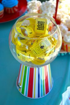 Hannah's Carnival Party | CatchMyParty.com-Easy looking... a pail turned upside down & glass bowl.  I like it.