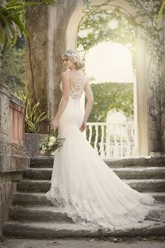 Layers of vintage tiered lace make this Essense of Australia wedding dress the perfect fit for your big day.