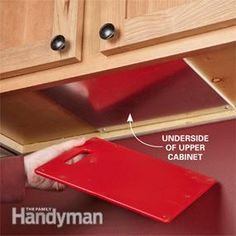 The Family Handyman: Hidden storage for cutting boards under upper cabinets using magnets - brilliant!