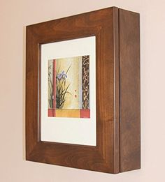 Caramel Picture Perfect Medicine Cabinet, a wall-mount picture frame medicine cabinet without mirror (Available in White, Coffee Bean, & Caramel) Wall Mounted Medicine Cabinet, Wall Mounted Bathroom Cabinets, Medicine Cabinets, Hidden Shelf, Solid Wood Shelves, Glass Panel Door, White Picture, Wood Wall, Picture Frames
