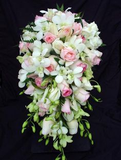 Pink rose and white singapore orchid teardrop bouquet