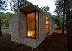Luciano Kruk Arquitectos complete concrete and glass cabin.